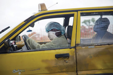 Sept. 3, 2014, Monrovia, Liberia: A taxi driver brings a sick woman to an Ebola clinic.