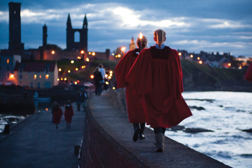 WALK ON: One tradition associated with the University of St. Andrews is the red gown worn by undergraduate students. Most students wear them on special occasions, one of those bring the Pier Walk, which takes place along the pier on East Sands after the St. Salvators Chapel service on Sunday - a precarious journey on a windy day.