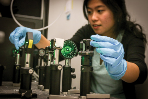 MIRROR MIRROR: Jenna Tan '16 adjusts mirrors to align a green laser for spectroscopy studies in Wustholz's lab.