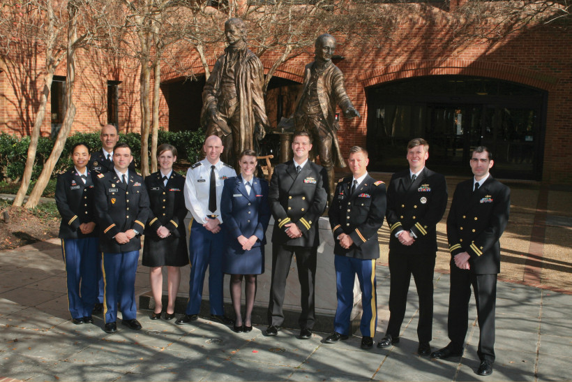 IN UNIFORM: Gum (center) is a second lieutenant with the United States Air Force, on educational delay for her law degree. When she graduates, she hopes to be accepted into the Judge Advocate General program.