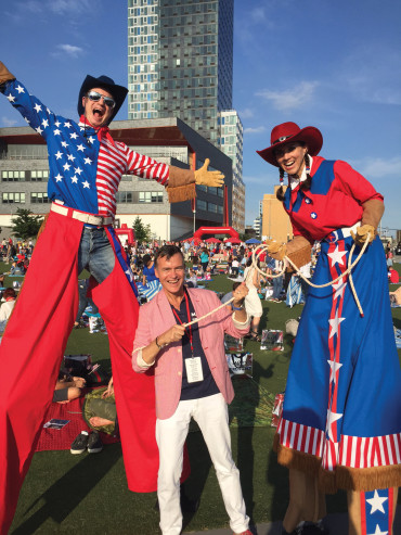 Bill Schermerhorn '82 wrangles the talent before Macy's Fourth of July Fireworks Show.