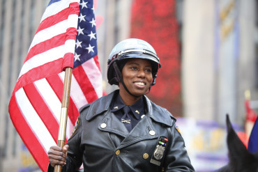 A NYPD officer rides in the Macy's Thanksgiving Day Parade.