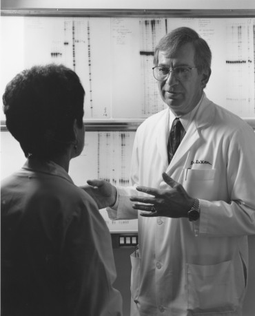 ON THE JOB: DeVita discusses lab results with a researcher at Yale Cancer Center where he served as director from 1993-2004. He is now the Amy and Joseph Perella Professor of Medicine at Yale.