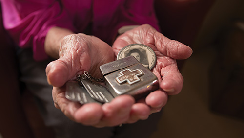 TIme capsule: Allen displays her dog tags, Red Cross Zippo lighter and I.D. badge from Ream General Veterans Hospital, where she worked at the beginning of World War II.