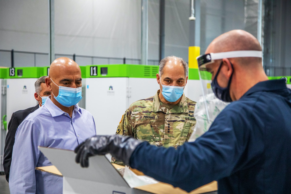 Dr. Moncef Slaoui and Army Gen. Gustave F. Perna visit a freezer farm